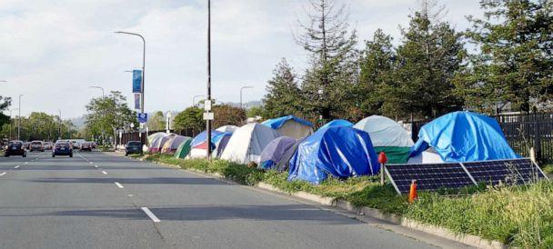 PHOTO: Cars drive past the a homeless encampment along a street in Berkeley, Calif., May 22, 2019. (Picture Alliance via Getty Images, FILE)