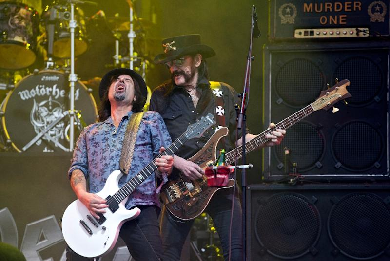 "British rock band Motorhead's lead singer Ian ""Lemmy"" Kilmister (R) and and lead guitarist Phil Campbell perform at the Glastonbury Festival of Music and Performing Arts in England on June 26, 2015"