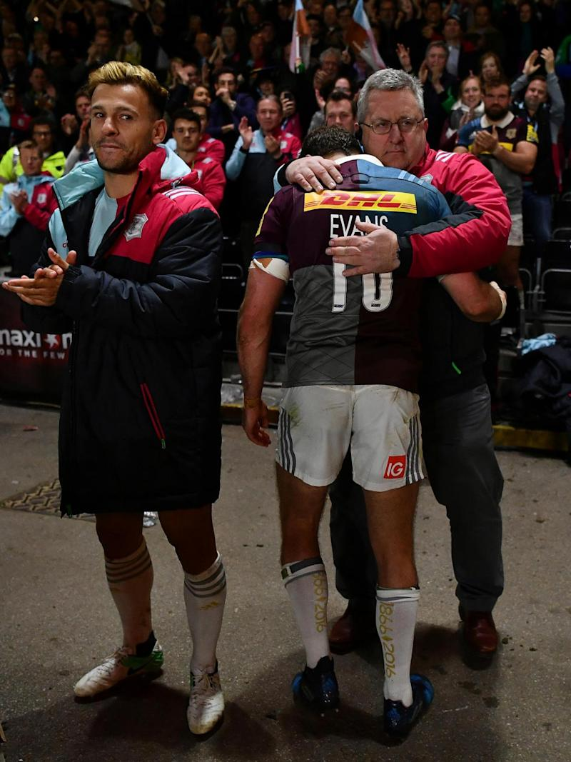 The departing Evans gets a hug from John Kingston, Harlequins Director of Rugby (Getty)