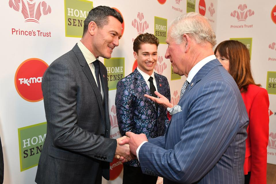 LONDON, ENGLAND - MARCH 13: Prince Charles, Prince of Wales meets Luke Evans at the annual Prince's Trust Awards at the London Palladium on March 13, 2019 in London, England. (Photo by Dominic Lipinski - WPA Pool/Getty Images)