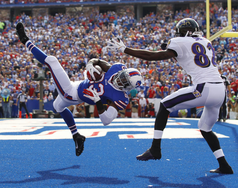 Buffalo Bills free safety Aaron Williams (23) intercepts a pass intended for Baltimore Ravens wide receiver Torrey Smith (82) during the second half of an NFL football game on Sunday, Sept. 29, 2013, in Orchard Park, N.Y. (AP Photo/Bill Wippert)