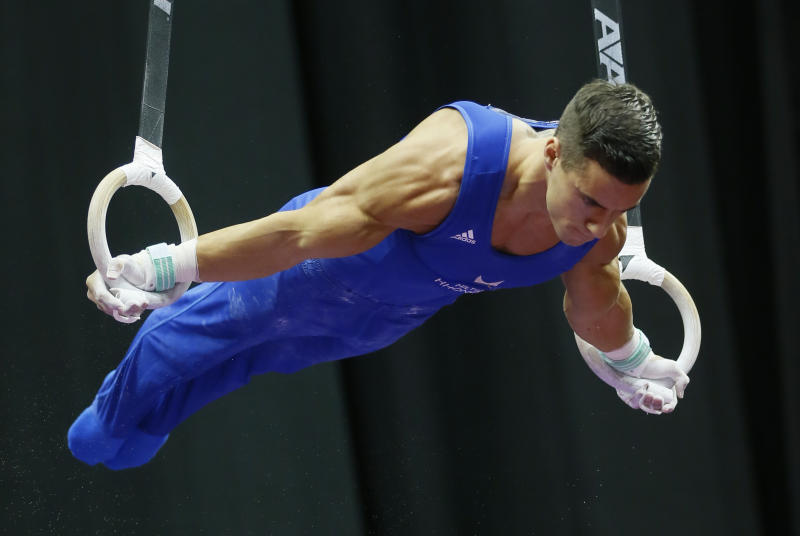 Jacob Dalton competes on the rings at the U.S. men's gymnastic championships on Sunday, Aug. 24, 2014, in Pittsburgh. (AP Photo/Keith Srakocic)