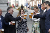 U.S. Secretary of State Mike Pompeo, second left, his wife Susan Pompeo, third left, Czech Republic's Foreign Minister Tomas Petricek, second right, and Petricek's wife Iva, third right, hold a glass of beer during a visit at a brewery in Pilsen near Prague, Czech Republic, Tuesday, Aug. 11, 2020. U.S. Secretary of State Mike Pompeo is in Czech Republic at the start of a four-nation tour of Europe. Slovenia, Austria and Poland are the other stations of the trip. (AP Photo/Petr David Josek, Pool)