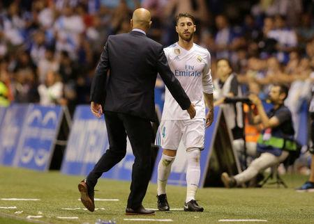 Soccer Football - La Liga - Deportivo de la Coruna vs Real Madrid - A Coruna, Spain - August 20, 2017   Real Madrid's Sergio Ramos after being sent off shakes hands with coach Zinedine Zidane   REUTERS/Miguel Vidal