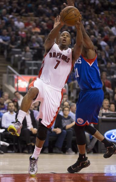 Toronto Raptors guard Kyle Lowry (7) is fouled on his way to the basket by Philadelphia 76ers forward Thaddeus Young (21) during first half NBA action in Toronto on Wednesday, April 9, 2014. (AP Photo/The Canadian Press, Peter Power)