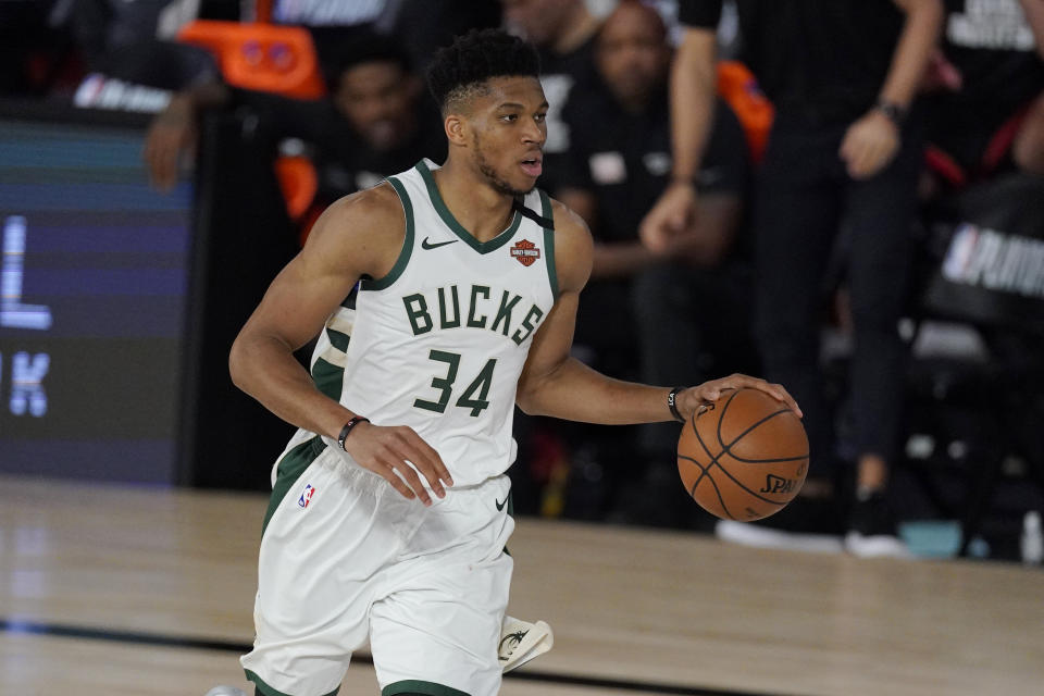 Milwaukee Bucks' Giannis Antetokounmpo (34) in the second half of an NBA conference semifinal playoff basketball game against the Miami Heat Friday, Sept. 4, 2020, in Lake Buena Vista, Fla. (AP Photo/Mark J. Terrill)