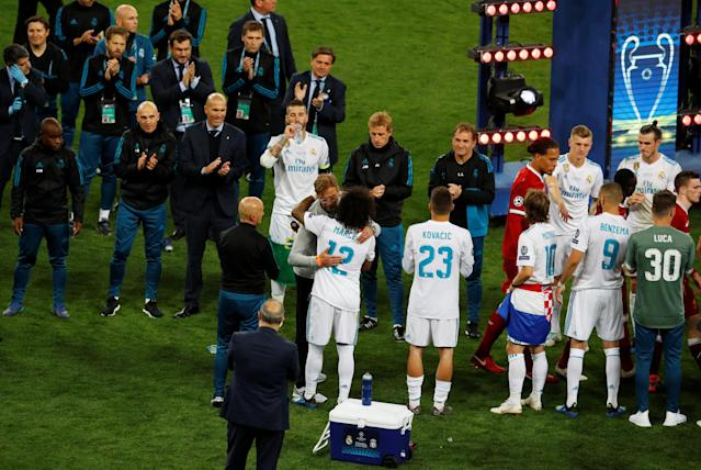 Soccer Football - Champions League Final - Real Madrid v Liverpool - NSC Olympic Stadium, Kiev, Ukraine - May 26, 2018 Liverpool manager Juergen Klopp with Real Madrid's Marcelo after losing the Champions League final REUTERS/Phil Noble