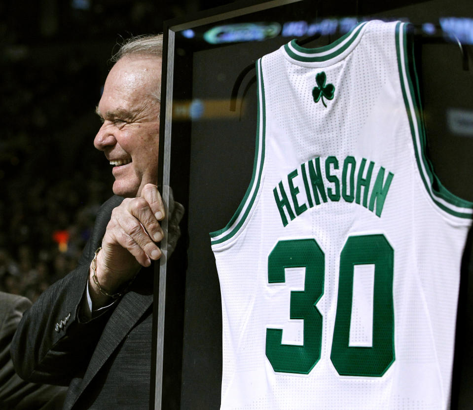 FILE - In this March 16, 2011, file photo, Boston Celtics broadcaster Tommy Heinsohn smiles as he receives a commemorative jersey prior to an NBA basketball game between the Celtics and the Indiana Pacers in Boston. Tommy Heinsohn, who as a Boston Celtics player, coach and broadcaster was with the team for all 17 of its NBA championships, has died. He was 86. The team confirmed Heinsohn's death on Tuesday, Nov. 10, 2020. (AP Photo/Elise Amendola, File)