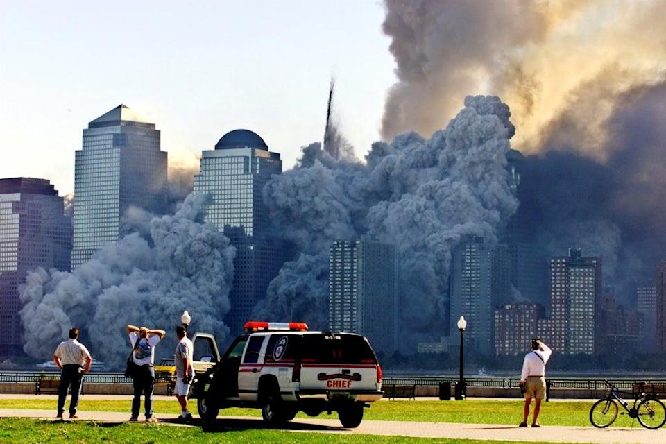 Tower 2 dissolves in a cloud of dust and debris about half an hour after the first Twin Tower collapsed (Reuters)
