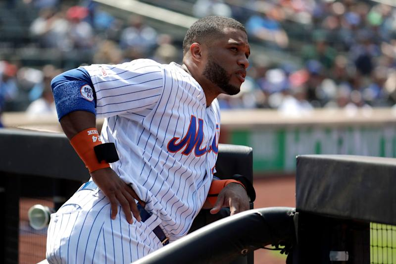 New York Mets second baseman Robinson Cano watches action from the steps of the dugout during the bottom of the seventh inning of a baseball game against the Cincinnati Reds, Thursday, May 2, 2019, in New York.(AP Photo/Julio Cortez)