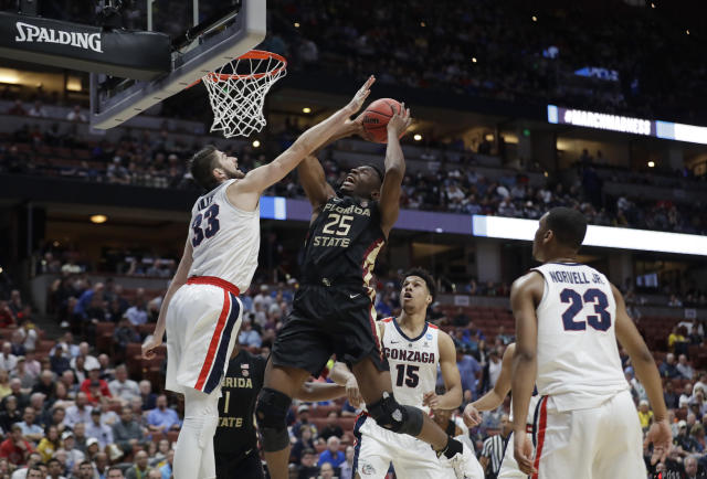 <p>Florida State forward Mfiondu Kabengele (25) shots over Gonzaga forward Killian Tillie, left, during the first half of a men's NCAA Tournament college basketball West Regional semifinal game Thursday, March 28, 2019, in Anaheim, Calif. (AP Photo/Marcio Jose Sanchez) </p>