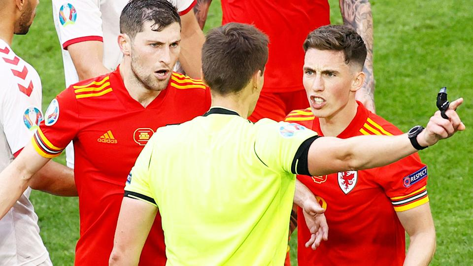 Harry Wilson, pictured here arguing with the referee after being sent off against Denmark.