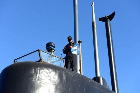 A crew member of the Argentine military submarine ARA San Juan stands on the vessel at the port of Buenos Aires, Argentina June 2, 2014. Picture taken on June 2, 2014. Armada Argentina/Handout via REUTERS