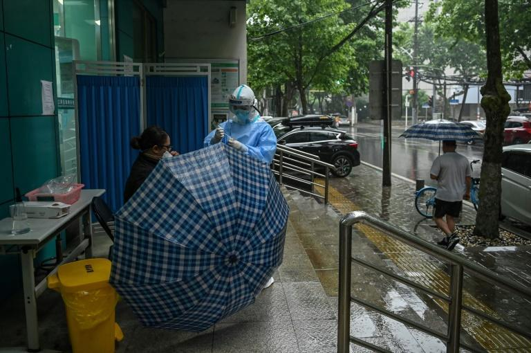 China has largely brought its coronavirus outbreak under control, but it has been on edge about a potential second wave of infections (AFP Photo/Hector RETAMAL)