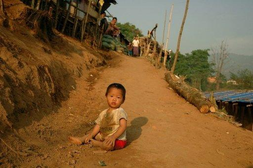 A Kachin child plays in a refugee camp on the border with China. Thousands of families have fled the fighting