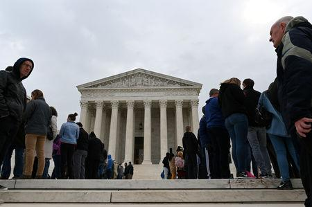 FILE PHOTO: People wait in line outside the U.S. Supreme Court to hear the orders being issued, in Washington, U.S. March 18, 2019. REUTERS/Erin Scott/File Photo