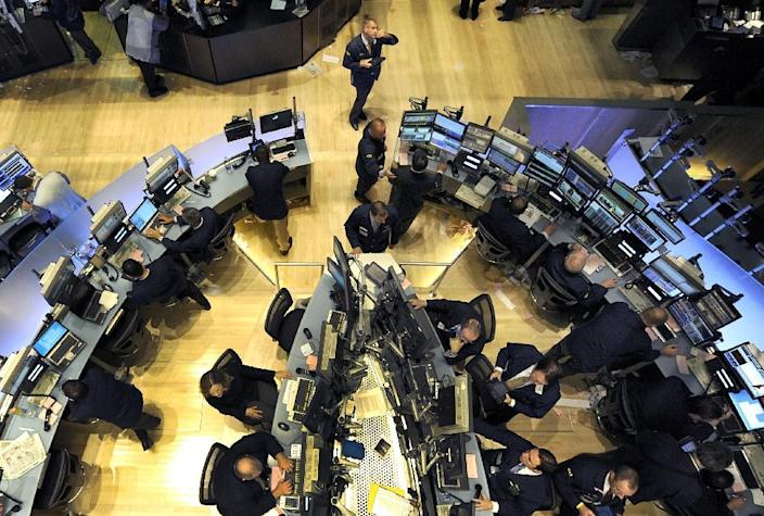 About 50 minutes into trading, the Dow Jones Industrial Average was at 20,376.15, up 0.5 percent (AFP Photo/TIMOTHY A. CLARY)