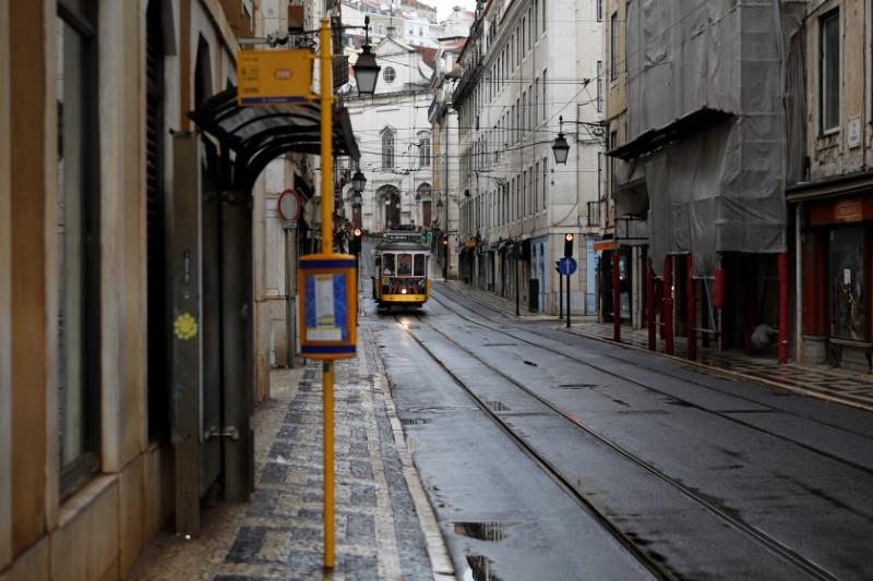 A tram is pictured at an empty street as the spread of the coronavirus disease (COVID-19) continues in downtown Lisbon