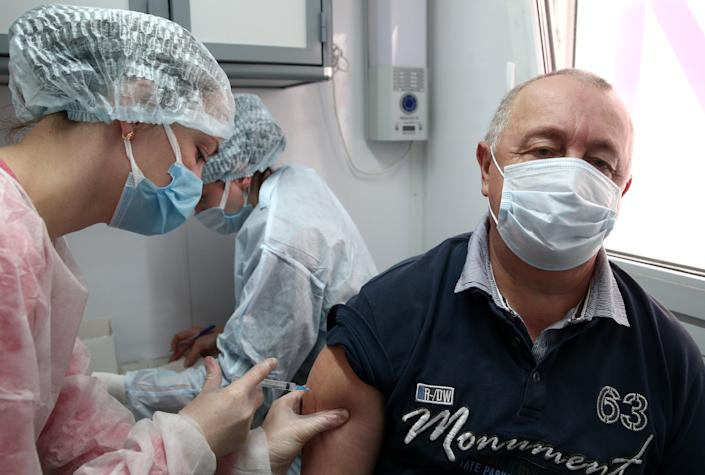 SEVASTOPOL, RUSSIA  APRIL 14, 2021: A man receives the Gam-COVID-Vac vaccine (under the brand name of Sputnik V) at a mobile COVID-19 vaccination unit. Since the start of the pandemic, Sevastopol has confirmed more than 13,694 cases of COVID-19. Since mid-March, the number of new confirmed cases has been increasing in Sevastopol by more than 30 daily. Sergei Malgavko/TASS (Photo by Sergei Malgavko\TASS via Getty Images)