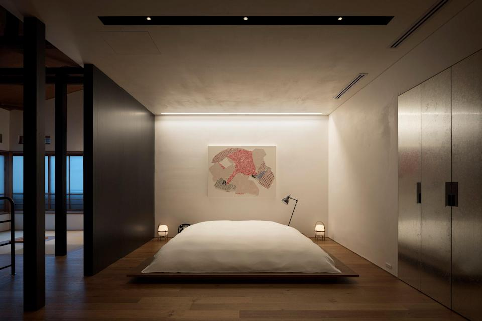 """<p><strong>Set the scene</strong> Dubbed a """"one-room hotel,"""" this former geisha house in <a href=""""https://www.cntraveler.com/destinations/tokyo?mbid=synd_yahoo_rss"""" rel=""""nofollow noopener"""" target=""""_blank"""" data-ylk=""""slk:Tokyo's"""" class=""""link rapid-noclick-resp"""">Tokyo's</a> residential Kagurazaka area has been transformed into what feels like the private home of a design-loving Tokyoite. Firmly delivering on the founder's dream of making a hideaway where folks would yearn to host artsy salon-style gatherings, it has every comfort for hunkering down, but works equally well if you're inviting pals over for an impromptu party. Most thrilling is the hidden-behind-a-door, tech-heavy, soundproofed tiny disco room, with curved white leather banquettes, neon-lit dance floor, karaoke machine, and well-stocked bar (it's said to have cost approximately $10 million yen to kit out).</p> <p><strong>What's the backstory?</strong> For its second opening, the team behind quirky, 15-room boutique <a href=""""https://www.cntraveler.com/hotels/tokyo/trunk-hotel?mbid=synd_yahoo_rss"""" rel=""""nofollow noopener"""" target=""""_blank"""" data-ylk=""""slk:Trunk (Hotel)"""" class=""""link rapid-noclick-resp"""">Trunk (Hotel)</a> in Shibuya has delivered something equally exciting and offbeat—a take-over-as-your-own, exclusive crash pad that's half an hour from the original. Trunk's founder, Yoshitaka Nojiri, along with in-house design team Trunk Atelier and local design outfit Tripster, painstakingly restored this 70-year-old geisha house, from the external black fencing and close-to-the-entrance pine trees (these are historical signifiers of a geisha residence) to the fully revamped split-level room inside. It sleeps up to four, but plenty more can pop in and party.</p> <p><strong>What can we expect in our room?</strong> Everything, from Stephen Kenn metal-framed tan leather sofas to dark terrazzo floors and cotton-covered shoji windows, is astonishing. In the ground floor's dining-room slash high-tech kitchen, Japanese-"""