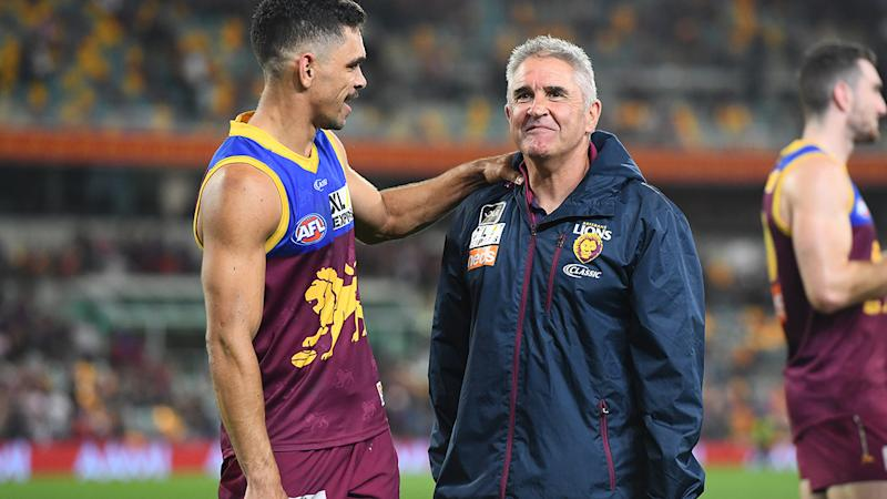 Charlie Cameron, left, and Brisbane Lions coach Chris Fagan, right, are pictured after their win over the Tigers.