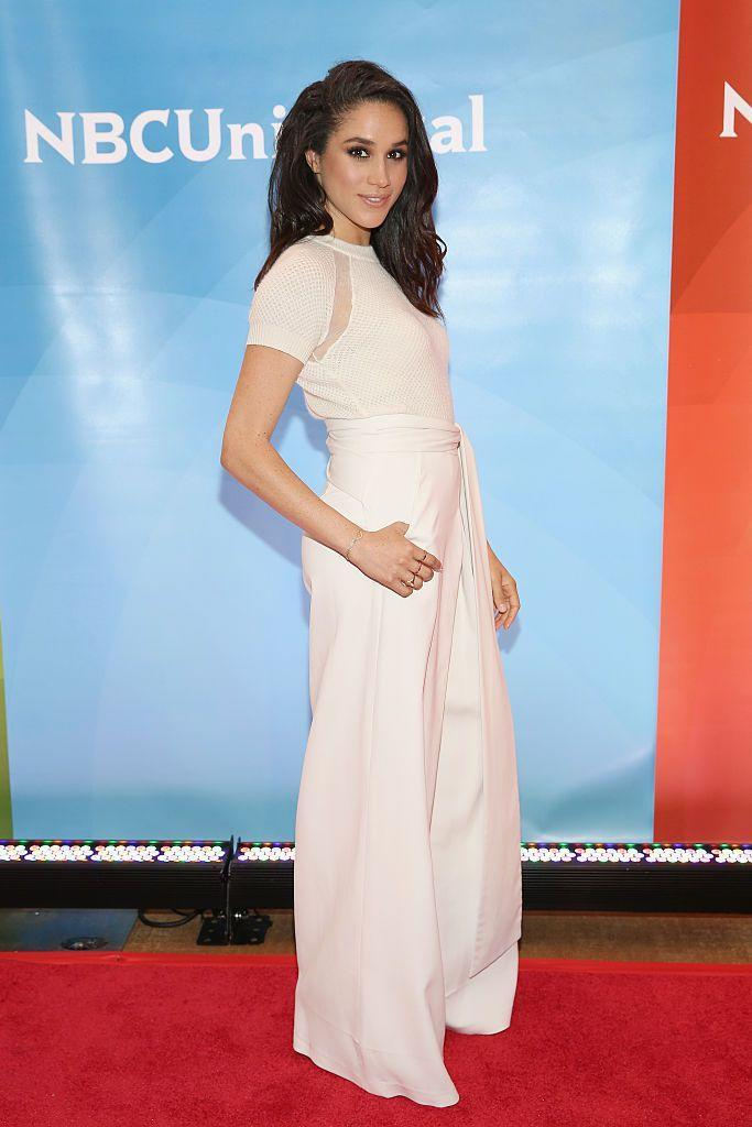 <p>Meghan's matching look here is actually two pieces—a pair of pants and a top (I want!). Megs wore this outfit to NBC's summer press day while she was still an actress on <em>Suits </em>in 2015. </p>