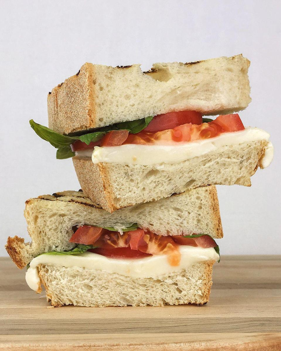 """<p>Whatever, salad. Caprese was made to be melted between bread.</p><p>Get the recipe from <a href=""""/cooking/recipe-ideas/recipes/a46498/caprese-grilled-cheese-recipe/"""" data-ylk=""""slk:Delish"""" class=""""link rapid-noclick-resp"""">Delish</a>.</p>"""