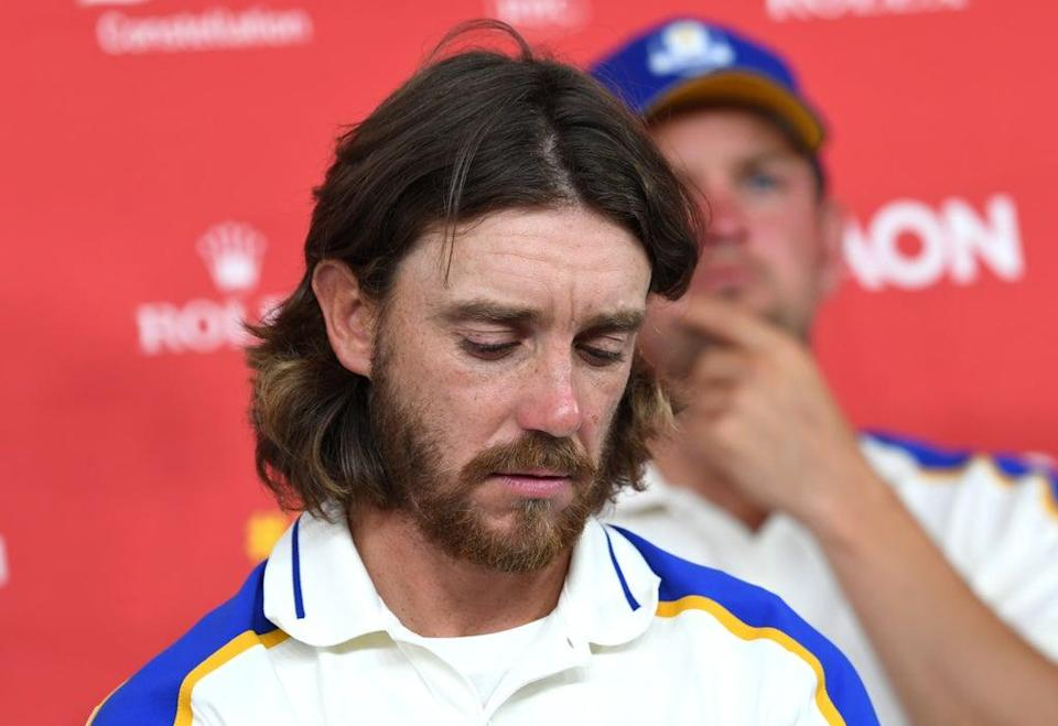 Europe's Tommy Fleetwood looking downcast during a press conference after Europe's Ryder Cup defeat (Anthony Behar/PA) (PA Wire)