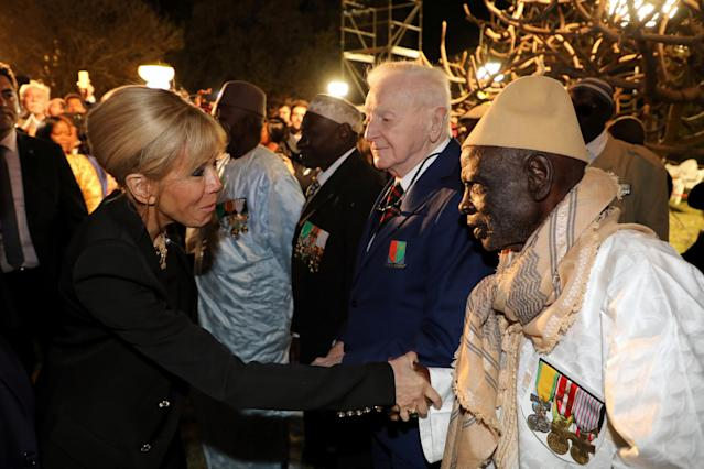 Brigitte Macron, the French president's wife, meets with French and Senegalese veterans in the garden of the French Embassy in Dakar, Senegal, February 2, 2018. REUTERS/Ludovic Marin/Pool