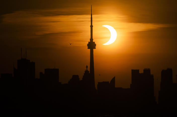 The sun rises behind the skyline during an annular eclipse on June 10, 2021, in Toronto, Canada. / Credit: Mark Blinch / Getty Images