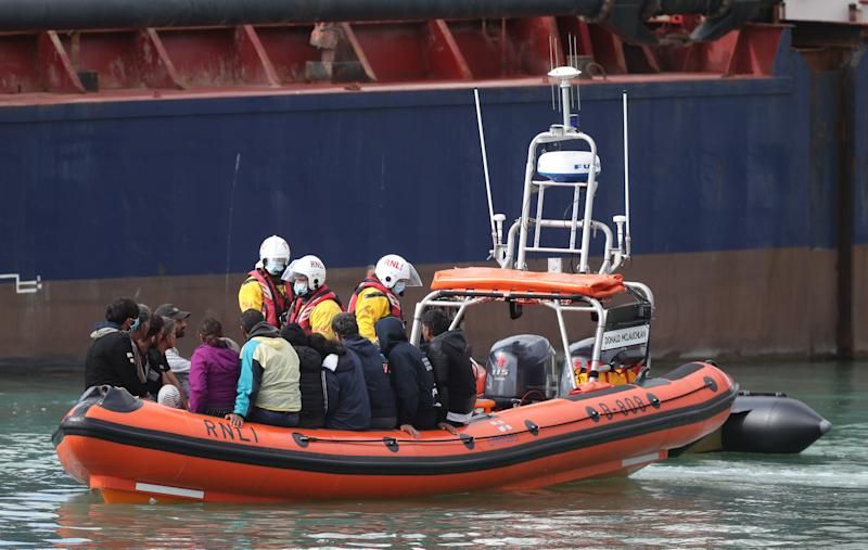 A group of people thought to be migrants are brought into Dover, Kent, by the RNLI following a small boat incident in the Channel. (Photo by Andrew Matthews/PA Images via Getty Images)