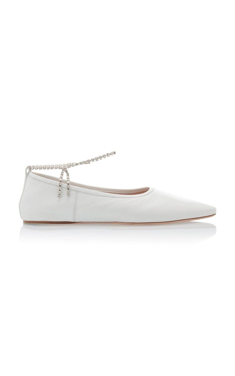 """<p><strong>Miu Miu</strong></p><p>modaoperandi.com</p><p><strong>$690.00</strong></p><p><a href=""""https://go.redirectingat.com?id=74968X1596630&url=https%3A%2F%2Fwww.modaoperandi.com%2Fwomen%2Fp%2Fmiu-miu%2Fleather-ballet-flats-2%2F384505&sref=https%3A%2F%2Fwww.harpersbazaar.com%2Fwedding%2Fbridal-fashion%2Fg36113322%2Fwedding-flats-for-brides%2F"""" rel=""""nofollow noopener"""" target=""""_blank"""" data-ylk=""""slk:SHOP NOW"""" class=""""link rapid-noclick-resp"""">SHOP NOW</a></p><p>Upgrade your flats with options that have built-in embellishments, like these crystal anklets. </p>"""