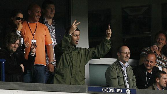 Oasis singer Liam Gallagher gestures to