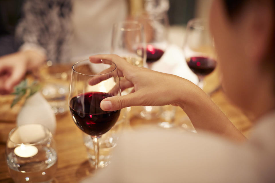 Drinking a bottle of wine a week holds the same cancer risk as smoking ten cigarettes as week [Photo: Getty]