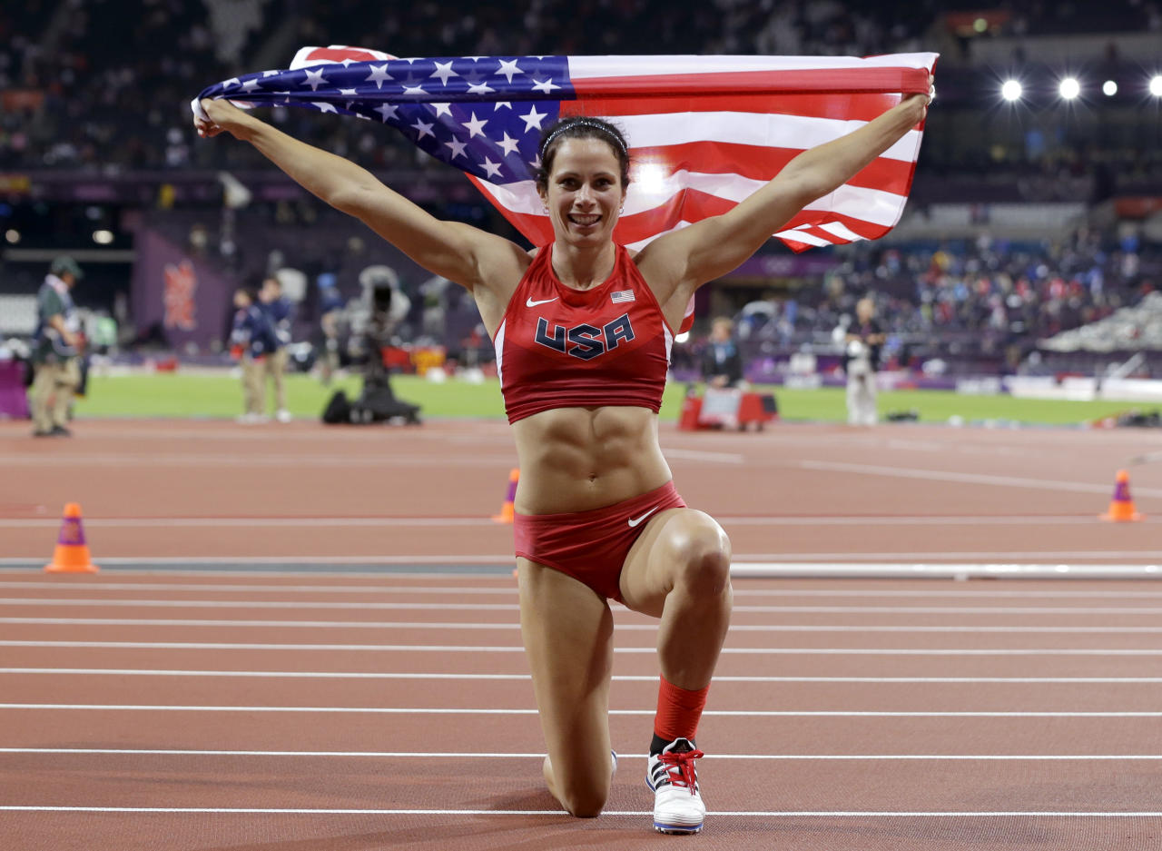 United States' Jennifer Suhr celebrates her gold medal win in the women's pole vault during the athletics in the Olympic Stadium at the 2012 Summer Olympics, London, Monday, Aug. 6, 2012. (AP Photo/Lee Jin-man)