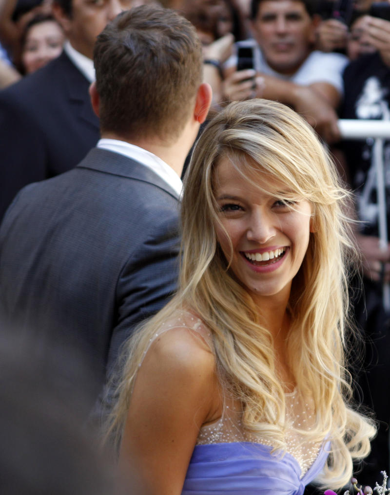 "Argentine TV actress Luisana Lopilato smiles beside her new husband, Canadian pop star Michael Buble after their civil wedding ceremony in Buenos Aires, Argentina, Thursday March 31, 2011. The Grammy-winning singer of ""Crazy Love"" and his Argentine sweetheart posed for a mob of fans after tying the knot. They plan a full ceremony with 300 guests next month at a mansion outside Buenos Aires, followed by another wedding in Vancouver in April. (AP Photo/Natacha Pisarenko)"