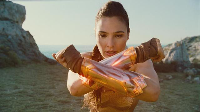 <p>The bullet-deflecting gauntlets can wield even more power when Diana crashes them together. (Photo: Warner Bros.) </p>