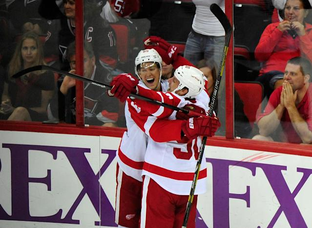 RALEIGH, NC - OCTOBER 04: Stephen Weiss #90 and Danny DeKeyser #65 of the Detroit Red Wings celebrate after Weiss's game-winning goal in overtime against the Carolina Hurricanes during play at PNC Arena on October 4, 2013 in Raleigh, North Carolina. The Red Wings defeated the Hurricanes 3-2 in overtime. (Photo by Grant Halverson/Getty Images)