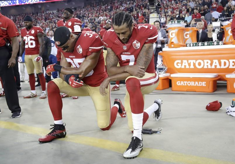 49ers safety Eric Reid, left, and quarterback Colin Kaepernick kneel during the national anthem before a game against the Rams in Santa Clara.