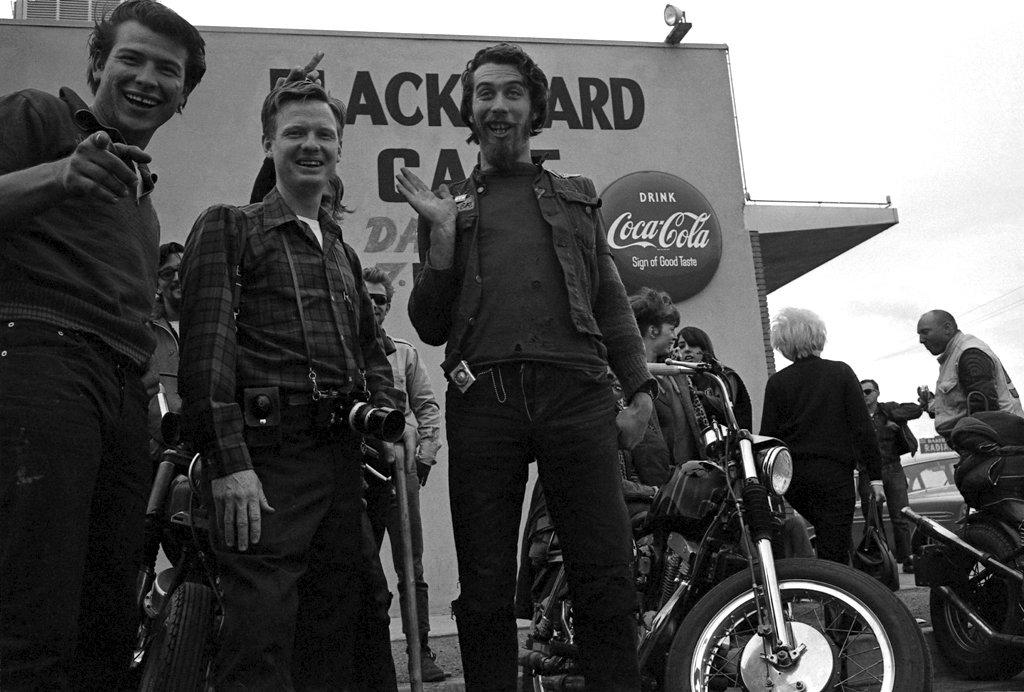 """In 1965, LIFE's Bill Ray spent several weeks with a gang that, to this day, serves as a living, brawling embodiment of the American outlaw: the Hells Angels. """"I got along with the Angels,"""" Ray (above, with camera) recalls. """"I got to like some of them very much, and I think they liked me. I accepted them as they were, and they accepted me. You know, by their standards I looked pretty funny. Just look at this picture -- that's some kind of a plaid shirt I've got on,"""" he says, incredulity mixing with amusement. """"But that was the best I could do to try to fit in!"""""""