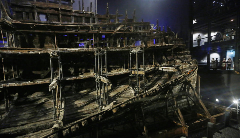 PORTSMOUTH, ENGLAND - JULY 19: Visitors view the hull of Henry VIII's warship, the Mary Rose after a £5.4m museum revamp on July 19, 2016 in Portsmouth, England. The ship, which was raised from the Solent in 1982, was launched in Portsmouth in 1511 and sank in 1545 at the Battle of the Solent, (Photo by Olivia Harris/Getty Images)