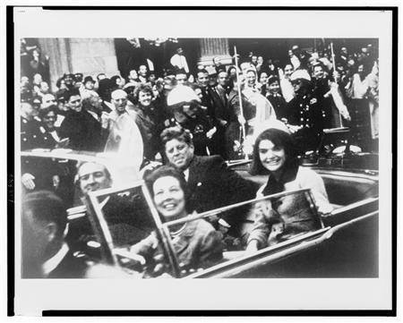 Former U.S. President John F. Kennedy (C), first lady Jacqueline Kennedy (R) and Texas Governor John Connally (L) and his wife are pictured riding in the presidential motorcade moments before Kennedy was shot in Dallas,Texas, in this handout image taken on November 22, 1963.REUTERS/Victor Hugo King