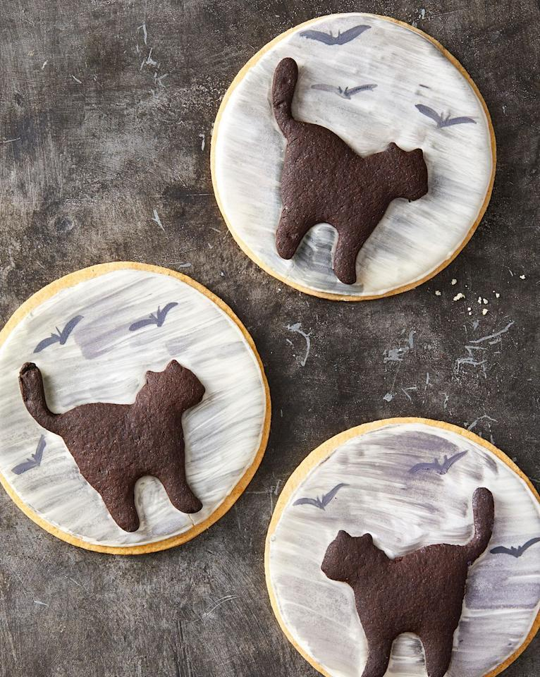 "<p>No bad luck here, only black cats crossing in front of a full moon.</p><p><em><a href=""https://www.goodhousekeeping.com/food-recipes/party-ideas/a28609114/black-cat-cookies-recipe/"" target=""_blank"">Get the recipe for Black Cat Cookies »</a></em></p>"