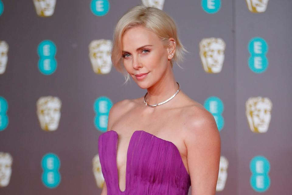 US-South African actress Charlize Theron poses on the red carpet upon arrival at the BAFTA British Academy Film Awards at the Royal Albert Hall in London on February 2, 2020. (Photo by Tolga AKMEN / AFP) (Photo by TOLGA AKMEN/AFP via Getty Images)