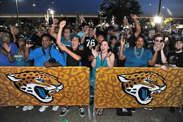 Jaguars fans cheer the first round choice of Central Florida's Blake Bortles by the Jacksonville Jaguars at the 2014 NFL Draft Party at EverBank Field on Thursday May 8, 2014, in Jacksonville, Fla. (AP Photo/Florida Times-Union/Bruce Lipsky)