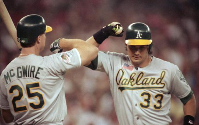 Mark McGwire and Jose Canseco are the subjects of a new visual rap album. (AP Photo/Al Behrman)