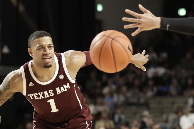 Texas A&M guard Savion Flagg chases after a loose ball against Vanderbilt in the first half of an NCAA college basketball game Saturday, Jan. 11, 2020, in Nashville, Tenn. (AP Photo/Mark Humphrey)