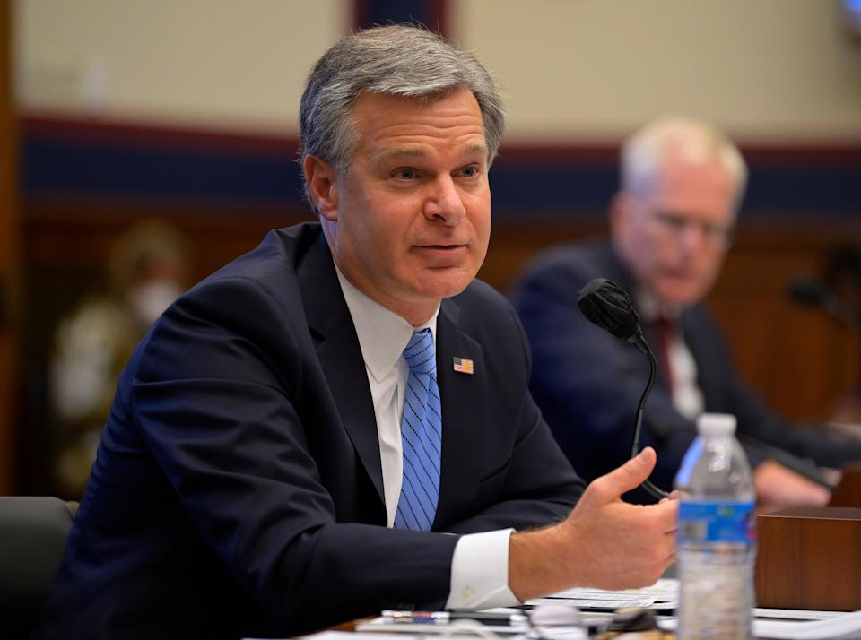 <p>Christopher Wray, appointed by Donald Trump in June 2017, has angered the president by failing to investigate election fraud</p> (EPA)