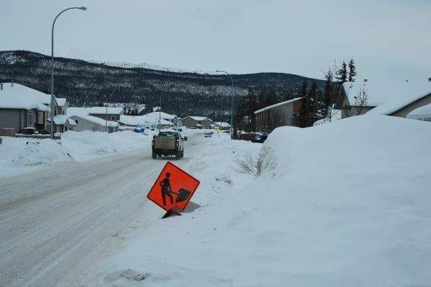 The snow is piled high alongside roads and sidewalks in Whitehorse this winter. (Mike Rudyk/CBC - image credit)
