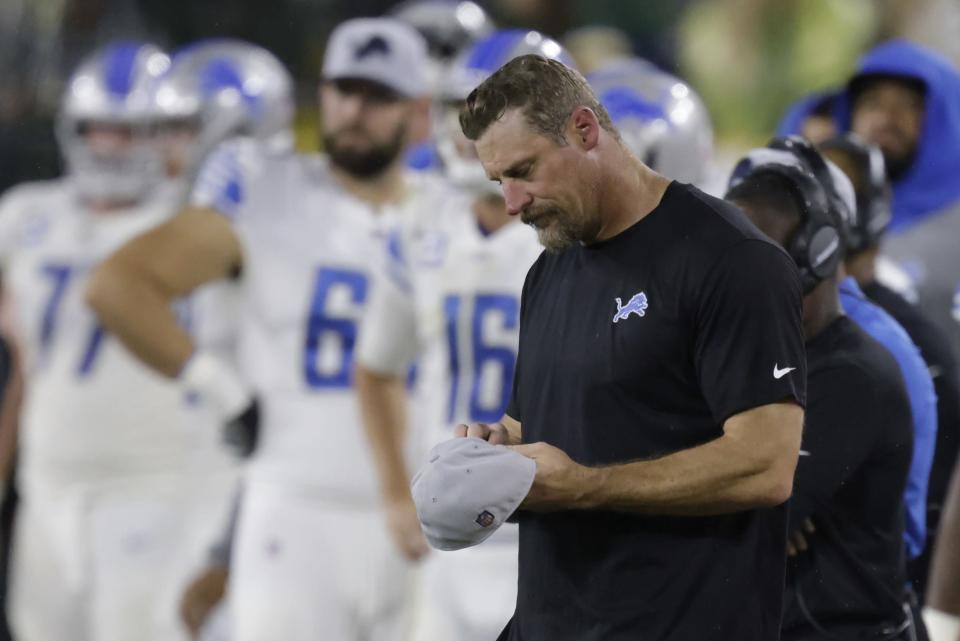 Detroit Lions head coach Dan Campbell looks down at his hat during the second half of an NFL football game against the Green Bay Packers Monday, Sept. 20, 2021, in Green Bay, Wis. The Packers won 35-17. (AP Photo/Matt Ludtke)